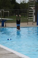 image of kid diving into swimming pool